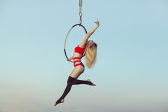 Woman acrobat in the air. Royalty Free Stock Image