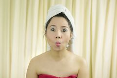 Woman acting smile, sad, funny, wear a skirt to cover her breast after wash hair, Wrapped in Towels After Shower stock image