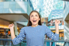 Woman acting surprised Stock Image