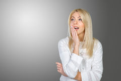 Woman acting surprised and confused. Blonde woman acting surprised and confused Stock Photo