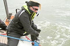 Woman in action during a sail competition Royalty Free Stock Photo