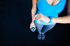 Woman with activity tracker. And shaker stock image