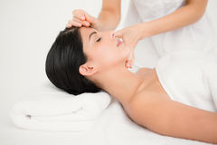 Woman in an acupuncture therapy Stock Photo