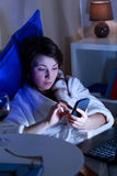 Woman addicted to modern technology Royalty Free Stock Photos