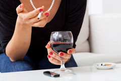 Woman with addictions Stock Images