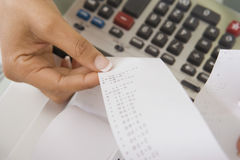 Woman With Adding Machine Tape Stock Photo