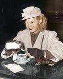 Woman adding sugar to beverage Royalty Free Stock Image