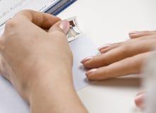 Woman addressing envelope. While paying bills Stock Photos