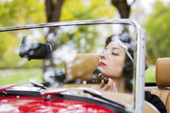 Woman adjust face before mirror at car Royalty Free Stock Photos