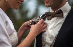 Woman adjusting boutonniere Royalty Free Stock Photo