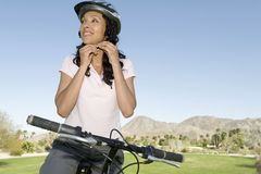 Woman Adjusting Cycling Helmet Stock Photos