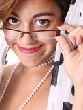 Woman adjusting her glasses Stock Images