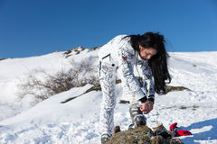 Woman Adjusting her Ski Gear at the Snow Stock Images