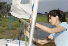 Woman Adjusting Sail Rigging - Horizontal Royalty Free Stock Photo