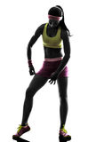 Woman adjusting sportswear silhouette Royalty Free Stock Images
