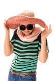 Woman adjusting sun hat Stock Images