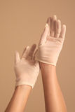 Woman adjusting vintage white gloves Stock Photography