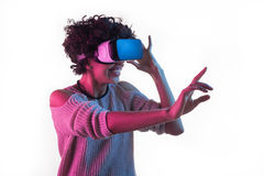 Woman adjusting VR headset and touching air Royalty Free Stock Photography
