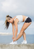 Woman adjusts her sportswear Royalty Free Stock Images