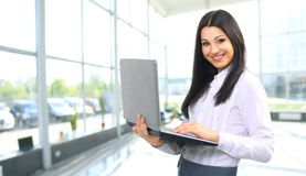 A woman administrator with laptop Royalty Free Stock Photos