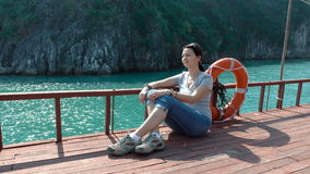 A woman admires the beautiful views of Ha Long Bay. stock video footage
