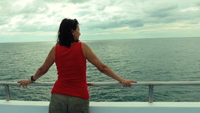 A woman admires the view of the sea stock footage