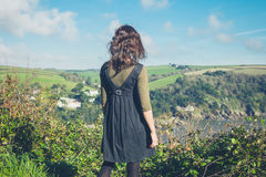 Woman admiring countryside from hill Royalty Free Stock Photo