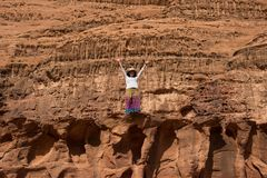 Woman admiring desert landscape on a cliff Royalty Free Stock Photos