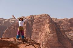 Woman admiring desert landscape on a cliff Stock Images