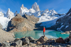 Woman admiring Fitz Roy scenic view Royalty Free Stock Photos