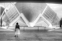 Woman admiring the Hemisfèric building. A woman looking at an abstract building in Valencia Royalty Free Stock Photography