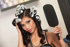Woman Admiring Her Hairdo Stock Photo