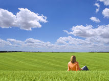Woman admiring the landscape. Woman admiring the landscape in the beautiful day Stock Photo