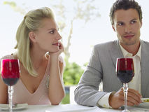 Woman Admiring Man At Dinner Table Royalty Free Stock Images