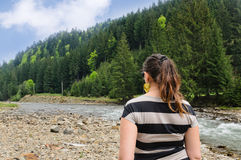 Woman admiring a mountain river Royalty Free Stock Images