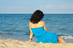 Woman admiring the ocean Stock Photos
