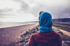 Woman admiring the sea on a cold autumn day Royalty Free Stock Image