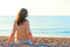 Woman admiring the sea while sitting Royalty Free Stock Images