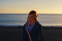 Woman admiring the sea at sunset royalty free stock photos