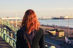 Woman admiring the sea at sunset stock photo
