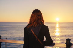 Woman admiring the sea at sunset royalty free stock images