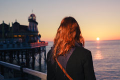 Woman admiring the sea at sunset Royalty Free Stock Photography