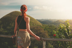 Woman admiring view of chocolate hils in Philippines Royalty Free Stock Photos