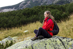 Woman admiring the view from the edge of a cliff Stock Images