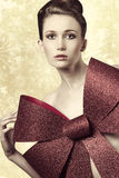 Woman adorned with bow Royalty Free Stock Images