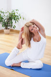 Woman in advanced yoga position Royalty Free Stock Photography