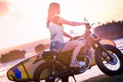 Woman adventure on motorcycle Stock Image