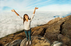 Woman in adventure. Woman on a mountain peak Royalty Free Stock Image
