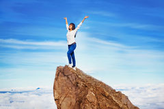 Woman in adventure. Woman on a mountain peak Stock Photography