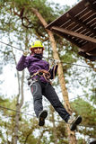Woman in an adventure park Royalty Free Stock Photo